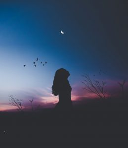 Woman watching sky after sunset