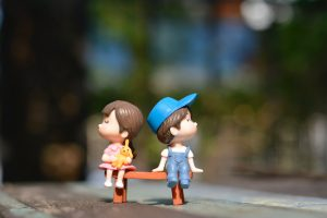 Image of toy boy and girl on bench