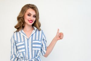 Image of woman giving thumbs up